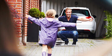 daughter running towards her father
