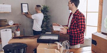friends unpacking boxes