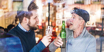 father and son having a beer