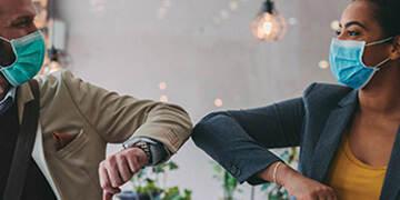 employees elbow greeting