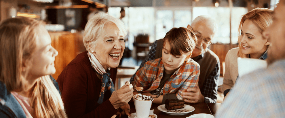 family having coffee and dessert