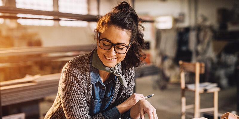 businesswoman reviewing blueprints