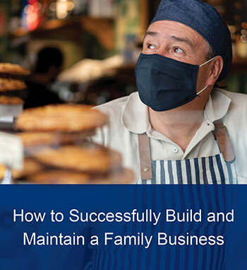 image tile showing business owner wearing a mask