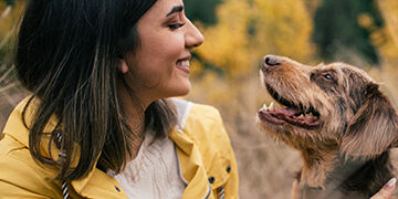 woman spending time outdoors with her dog