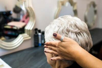 woman viewing her hairstyle