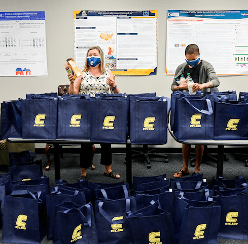 Drs. Shelton and Arnold back resident bags for research project.
