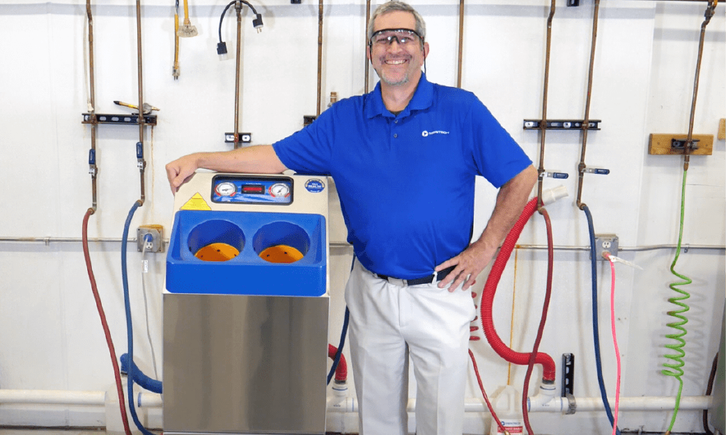 Troy standing with the CleanTech 2000S industrial automated hygiene station for manufacturing