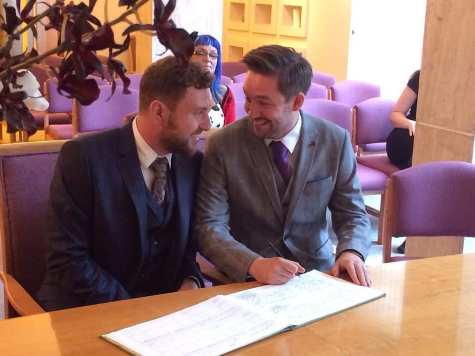 Jamie and Thomas Signing Documents