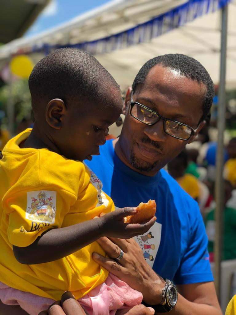 Dr. Nmazuo Ozuah with a young patient on International Childhood Cancer Day.