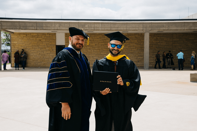 Graduate Osama Tamimi, right, from East Jerusalem, Palestine, pictured with his Fort Hays State University advisor, Jason Zeller, at last weekend's FHSU commencement.