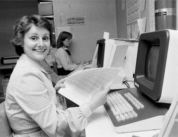 Press employee using an early computer