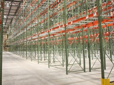 green and red used pallet rack in warehouse