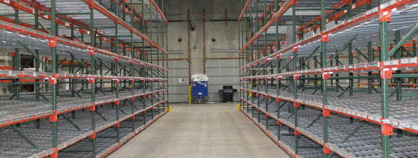 shelving down the aisle of a warehouse