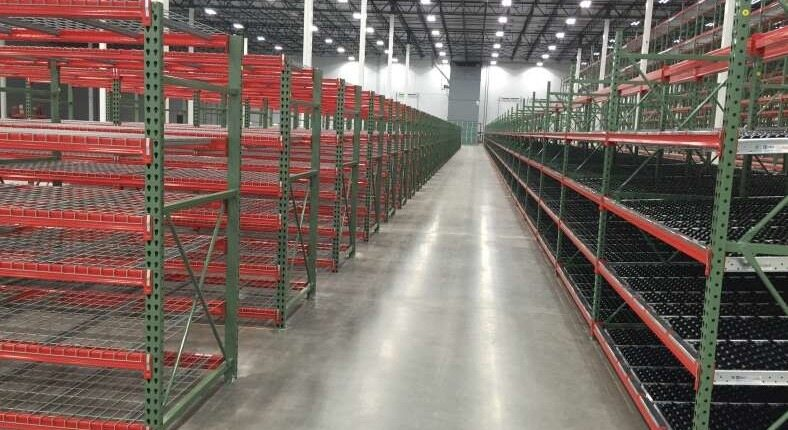 red and green shelving in warehouse