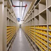 shelving with yellow bins