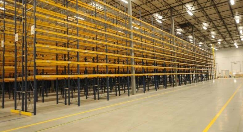 large warehouse with yellow shelving
