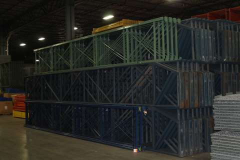 used pallet rack stacked in a warehouse
