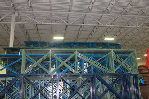 large quantities of pallet rack stacked