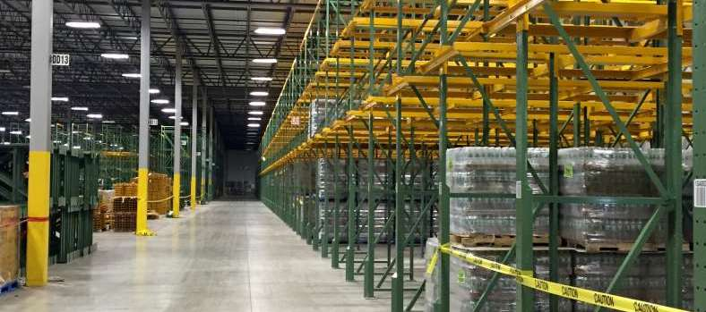 warehouse safety with yellow and green rack