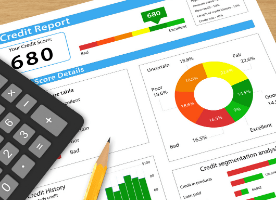 credit report and calculator on desk