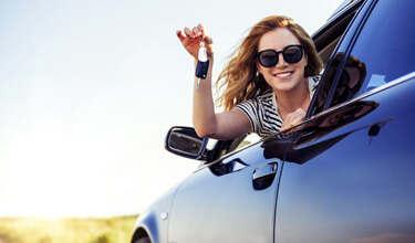 Woman holding keys to car